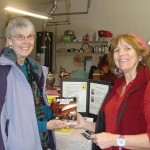 Local author, Sheri McGuinn (R), chats with readers and signs her books